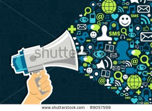 stock-photo-hand-holding-a-megaphone-throwing-social-media-icons-on-blue-background-89057599