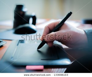 stock-photo-graphic-designer-using-digital-tablet-and-computer-in-the-office-133696103