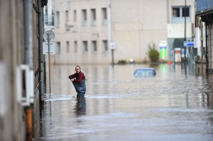 Britanny , France: A man walks in a flooded street in Morlaix