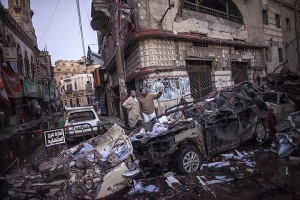 Mansura, Egypt: Egyptian men inspect destruction following a powerful car b