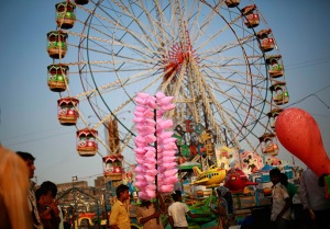 Mumbai, India: A man waits for customers to sell candy floss at the Mahim f